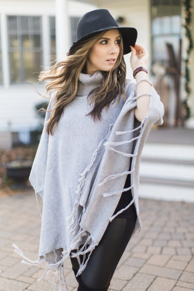 Bohemian inspired winter style with a fringe poncho, leather leggings, and black Steve Madden Gorgeous over the knee boots.