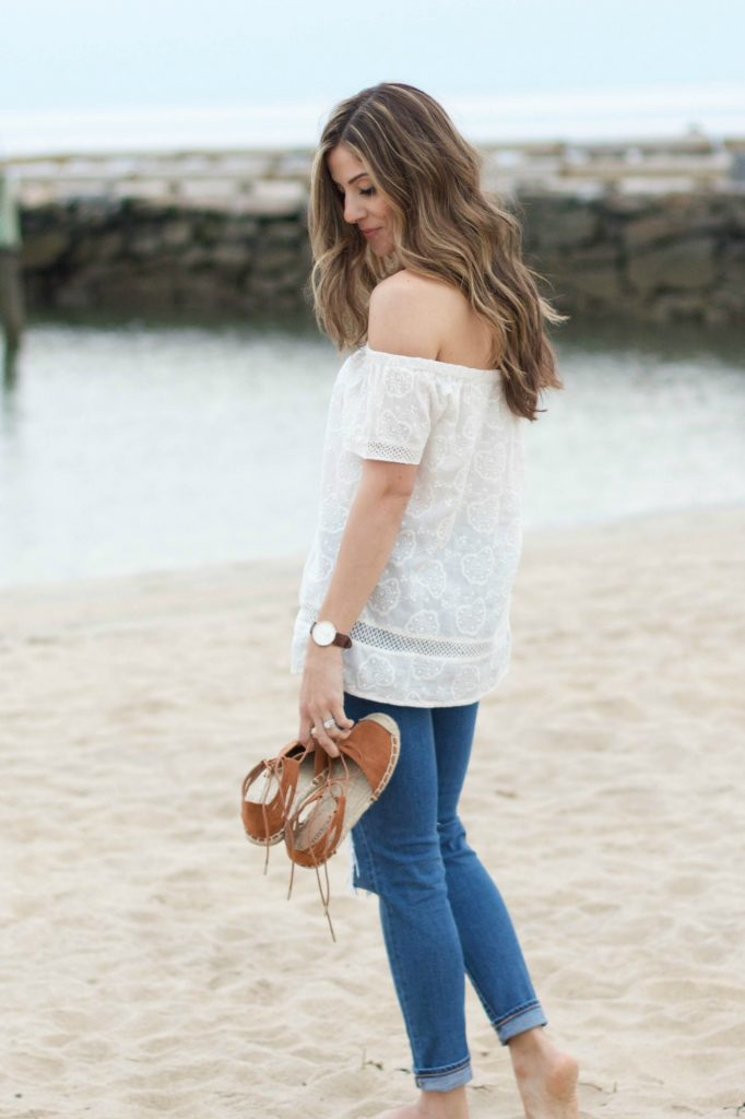 Spring style with a white off shoulder top and distressed jeans