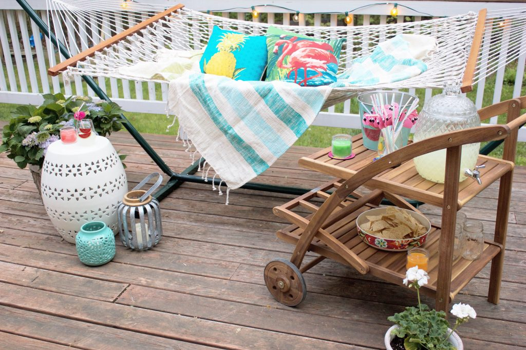 A tropical-inspired, relaxing backyard hammock retreat featuring World Market's Havana Club Collection