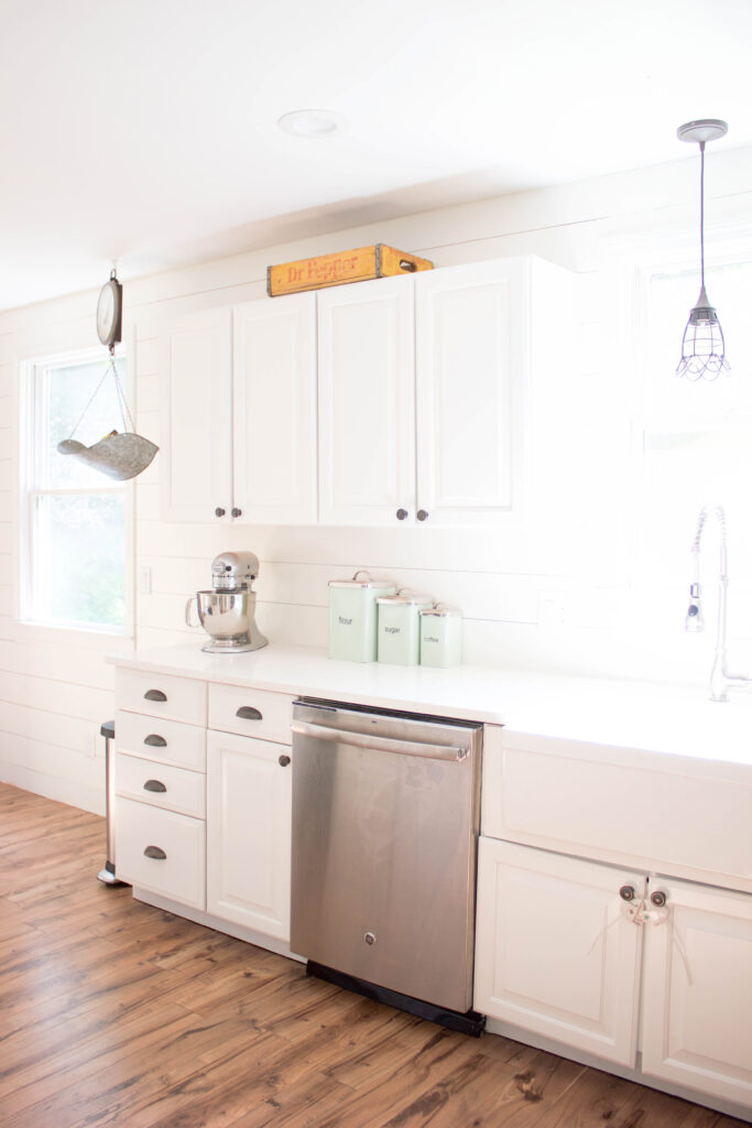 Farmhouse kitchen with shiplap walls, quartz countertops, and vintage accents