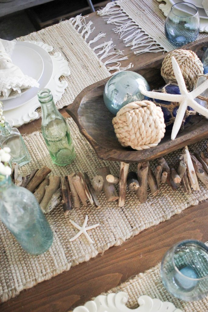 A coastal farmhouse summer tablescape featuring Pier 1