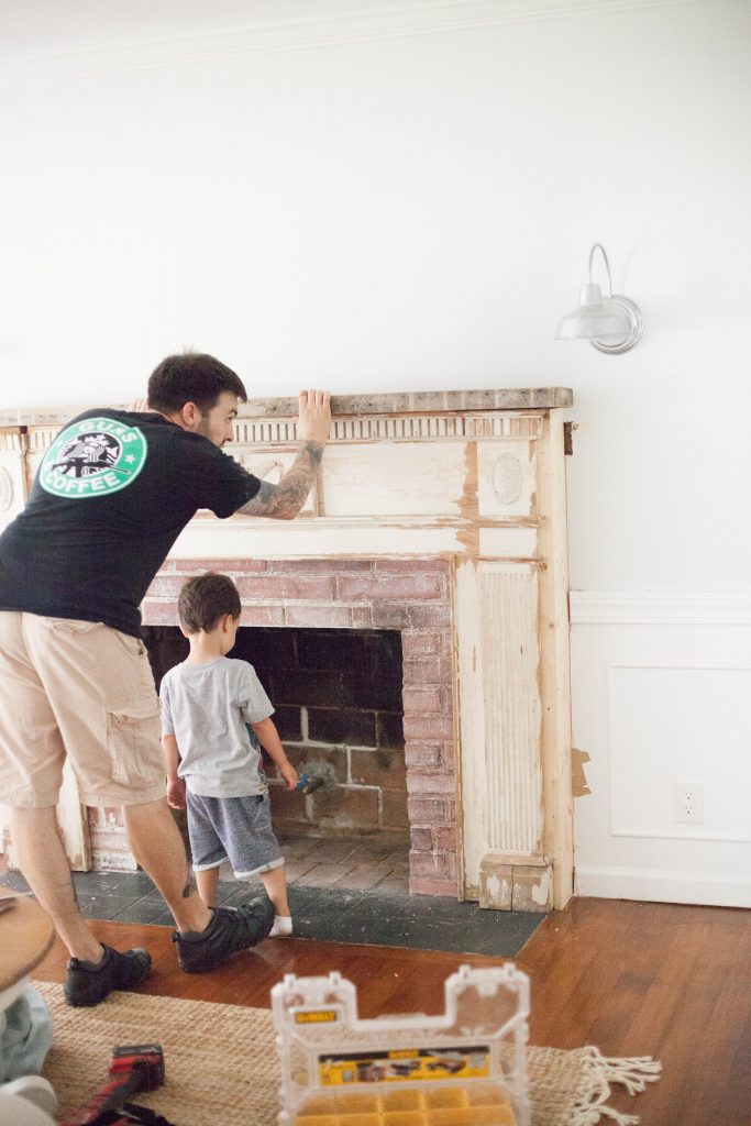 Our process for how to mount an antique mantle to our fireplace to add an antique flare to our living room.