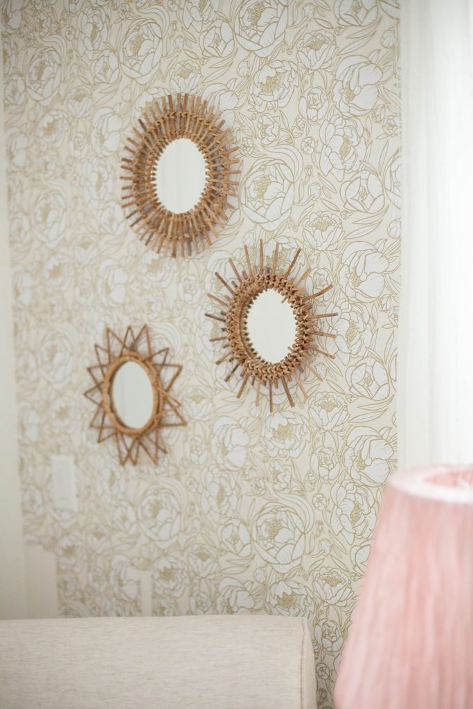 A whimsical, bohemian girl's nursery with removable wallpaper and glam accents