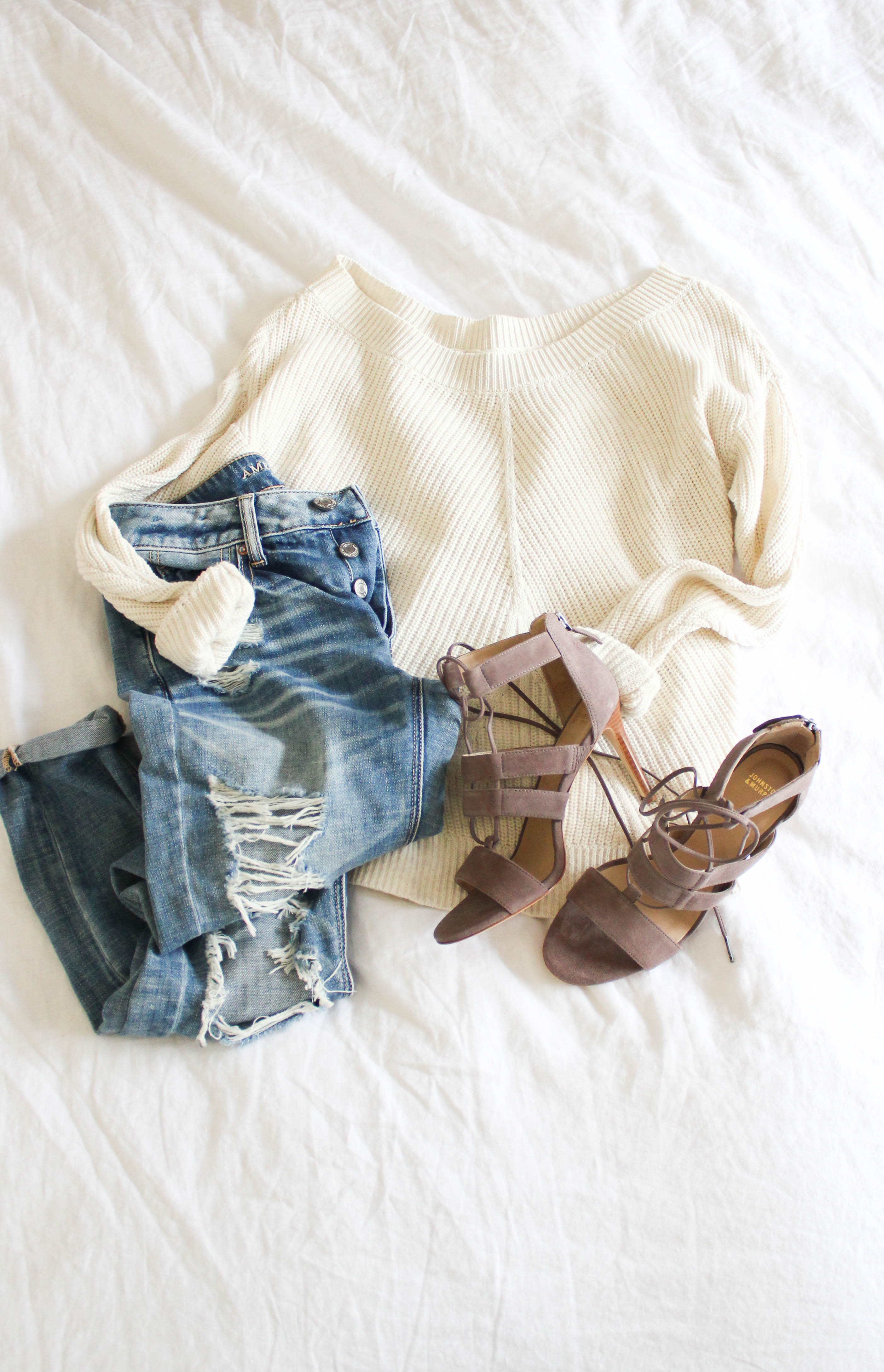 A casual way to style spring lace-up heels with distress boyfriend jeans and an off shoulder sweater.
