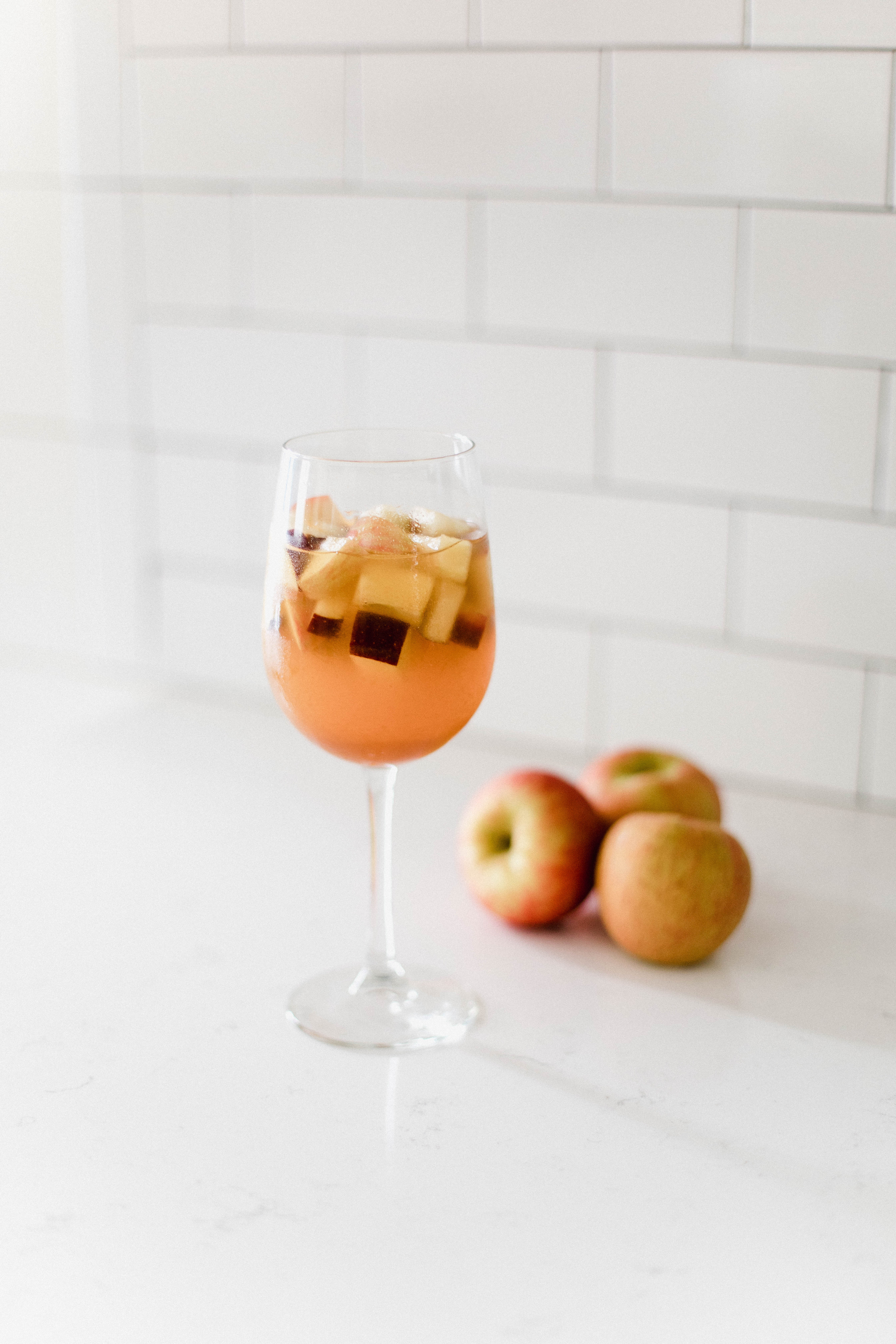 Connecticut life and style blogger Lauren McBride shares a Caramel Apple Cider Sangria recipe that's a fun, adult twist on a favorite fall beverage.