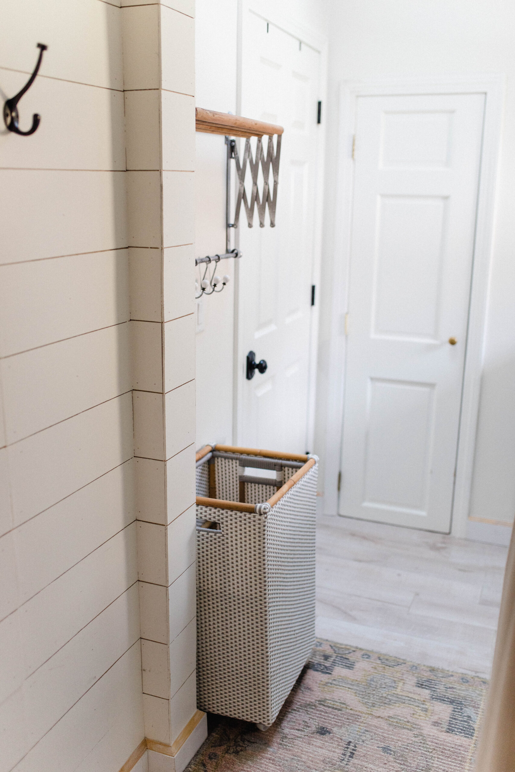 Connecticut life and style blogger Lauren McBride shares her laundry room, the small DIY projects that made a big impact, and sources.