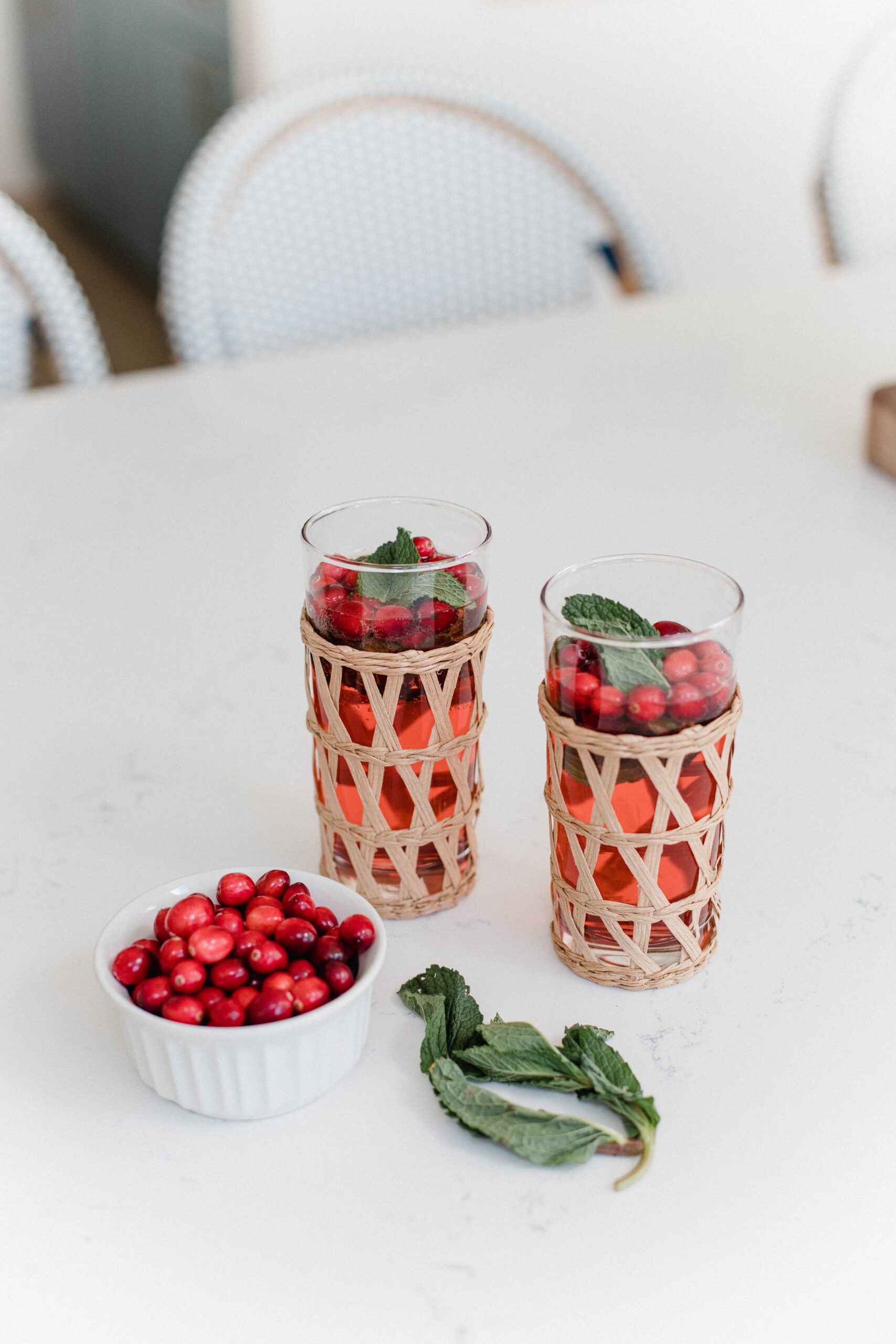 Looking for a festive holiday drink? This Cranberry Mint Lime Spritzer by Connecticut life and style blogger Lauren McBride is easy and delicious.