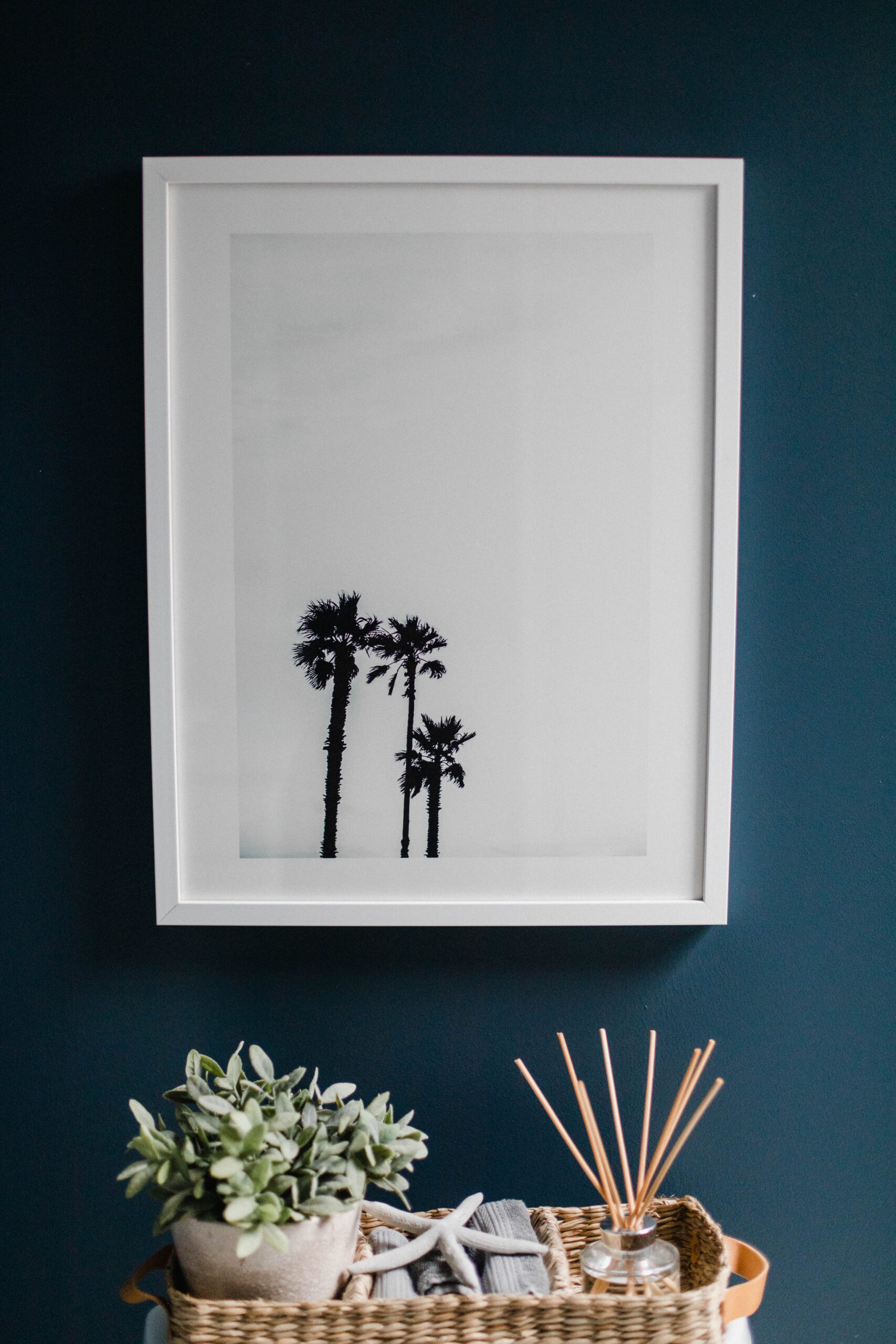 Connecticut life and style blogger Lauren McBride shares the coastal artwork in her modern coastal inspired home.