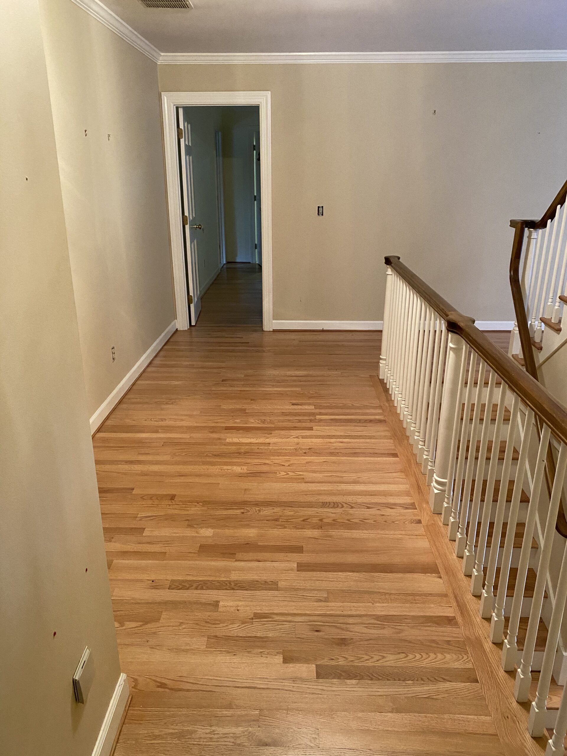 Connecticut life and style blogger Lauren McBride shares the process for bleaching and staining light, coastal-inspired wood flooring.